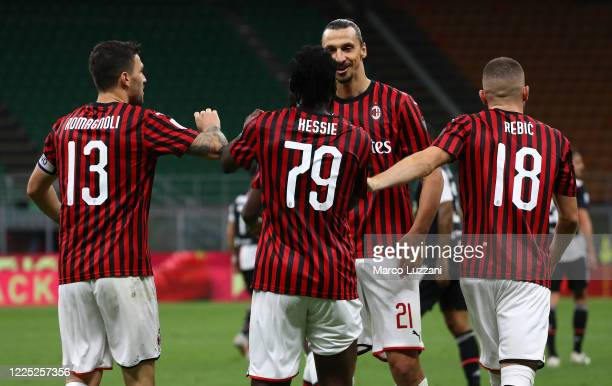 Franck Kessie of AC Milan celebrates his goal with his team-mate Zlatan Ibrahimovic during the Serie A match between AC Milan and Juventus at Stadio...