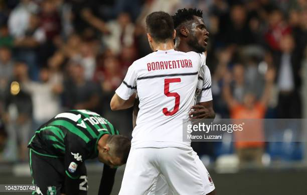 Franck Kessie of AC Milan celebrates with his teammate Giacomo Bonaventura after scoring the opening goal during the Serie A match between US...