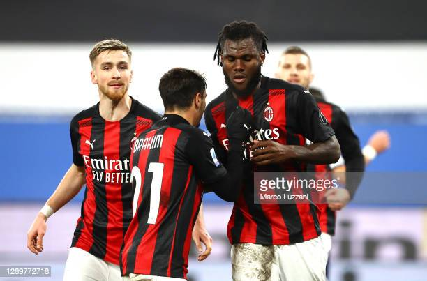Franck Kessie of AC Milan celebrates with team mate Brahim Diaz after scoring their sides first goal from the penalty spot during the Serie A match...