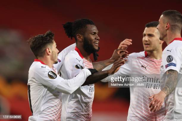 Franck Kessie of AC Milan celebrates with team mates after scoring a goal to make it 0-1 during the UEFA Europa League Round of 16 First Leg match...
