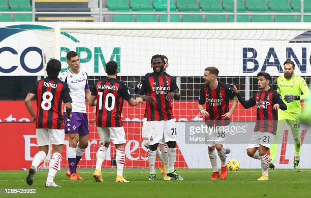 Franck Kessie of AC Milan celebrates with team mates after scoring their sides second goal from the penalty spot during the Serie A match between AC...