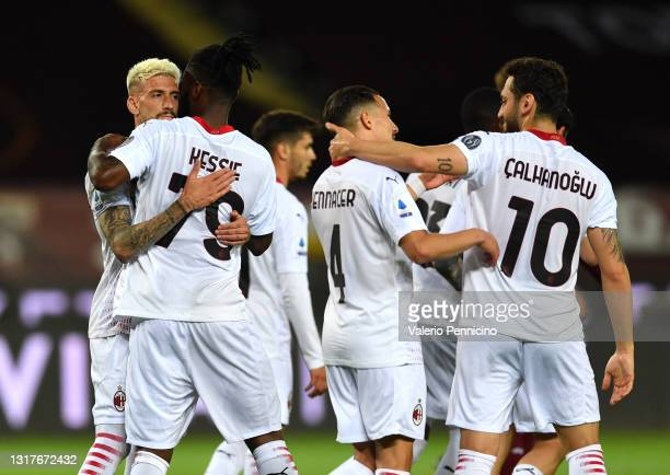 Franck Kessie of A.C. Milan celebrates with team mates after scoring their side's second goal during the Serie A match between Torino FC and AC Milan...
