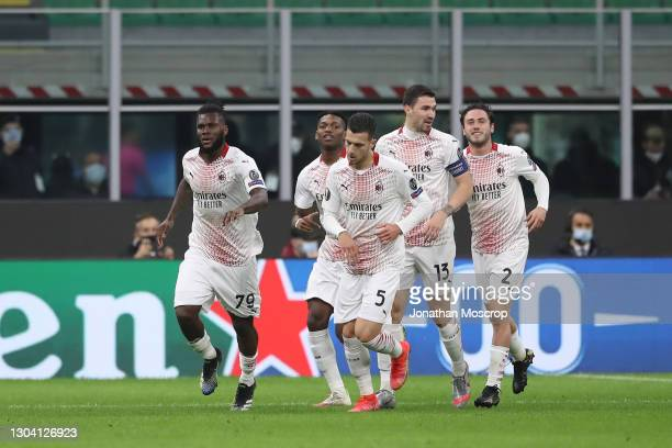 Franck Kessie of AC Milan celebrates with team mates after scoring to give the side a 1-0 lead during the UEFA Europa League Round of 32 match...