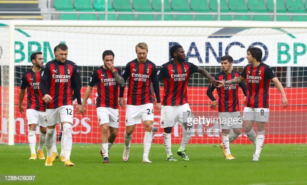 Franck Kessie of A.C. Milan celebrates with teammates after scoring their team's second goal from the penalty spot during the Serie A match between...