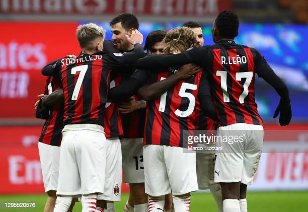 Franck Kessie of AC Milan celebrates with teammates after scoring their sides second goal from the penalty spot during the Serie A match between AC...