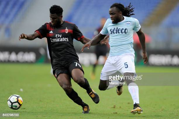 Franck Kessie of AC Milan compete for the ball with Jordan Lukaku of SS Lazio during the Serie A match between SS Lazio and AC Milan at Stadio...