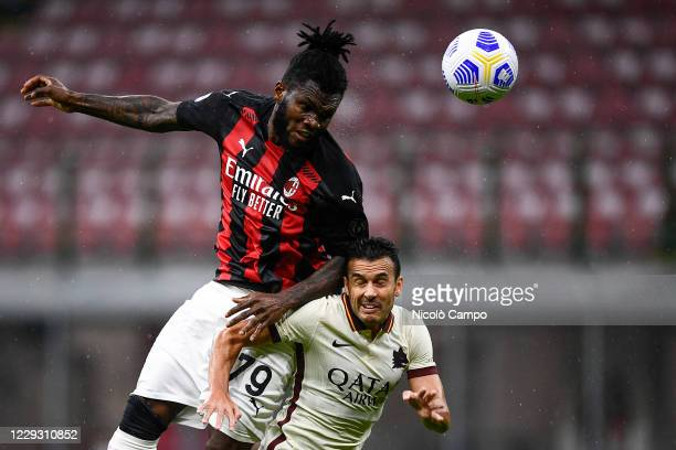 Franck Kessie of AC Milan competes for a header with Pedro Eliezer Rodriguez Ledesma of AS Roma during the Serie A football match between AC Milan...