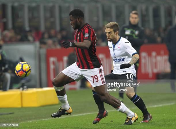 Franck Kessie of AC Milan competes for the ball with Alejandro Dario Gomez of Atalanta BC during the serie A match between AC Milan and Atalanta BC...