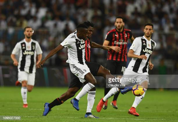 Franck Kessie of AC Milan competes for the ball with Blaise Matuidi of Juventusduring the Italian Supercup match between Juventus and AC Milan at...