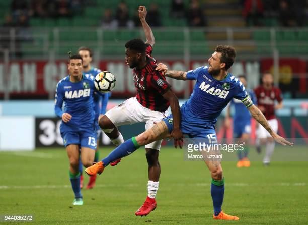 Franck Kessie of AC Milan competes for the ball with Francesco Acerbi of US Sassuolo during the serie A match between AC Milan and US Sassuolo at...