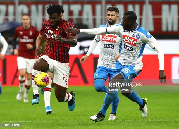 Franck Kessie of AC Milan competes for the ball with Kalidou Koulibaly of SSC Napoli during the Serie A match between AC Milan and SSC Napoli at...