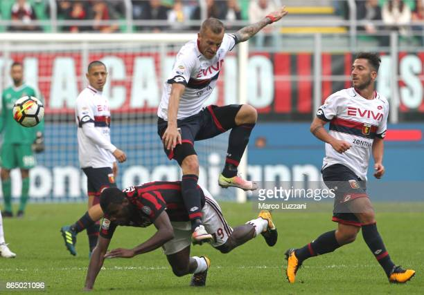 Franck Kessie of AC Milan competes for the ball with Luca Rigoni of Genoa CFC during the Serie A match between AC Milan and Genoa CFC at Stadio...