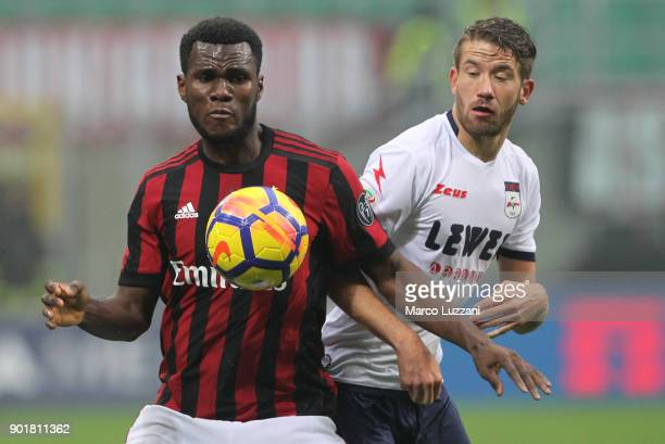 Franck Kessie of AC Milan competes for the ball with Marcus Christer Rohden of FC Crotone during the serie A match between AC Milan and FC Crotone at...