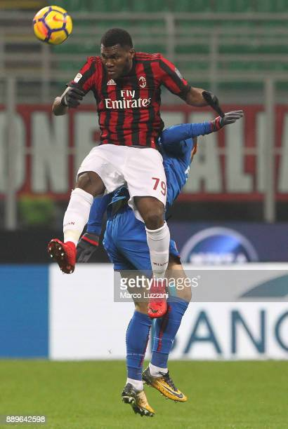 Franck Kessie of AC Milan competes for the ball with Mattia Destro of Bologna FC during the Serie A match between AC Milan and Bologna FC at Stadio...