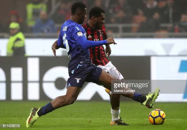 Franck Kessie of AC Milan competes for the ball with Quissanga Bastos of SS Lazio during the serie A match between AC Milan and SS Lazio at Stadio...