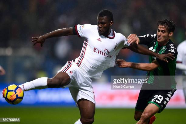 Franck Kessie of AC Milan competes with Francesco Cassata of US Sassuolo during the Serie A football match between US Sassuolo and AC Milan AC Milan...