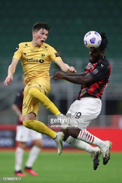 Franck Kessie of AC Milan heads away from Sondre Brustad Fet of FK Bodo/Glimt during the UEFA Europa League third qualifying round match between AC...