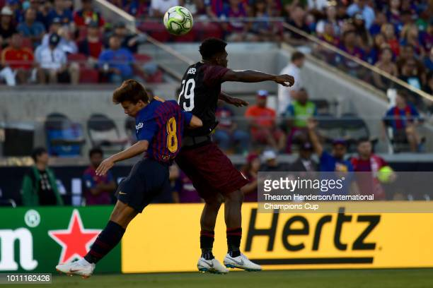Franck Kessie of AC Milan heads the ball against Ricky Puig of FC Barcelona during their International Champions Cup match at Levi's Stadium on...