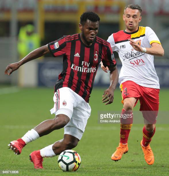 Franck Kessie of AC Milan is challenged by Gaetano Letizia of Benevento Calcio during the serie A match between AC Milan and Benevento Calcio at...