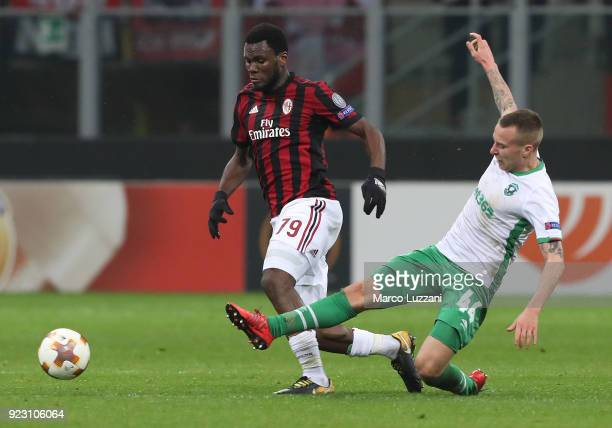 Franck Kessie of AC Milan is challenged by Jacek Goralski of Ludogorets Razgrad during UEFA Europa League Round of 32 match between AC Milan and...