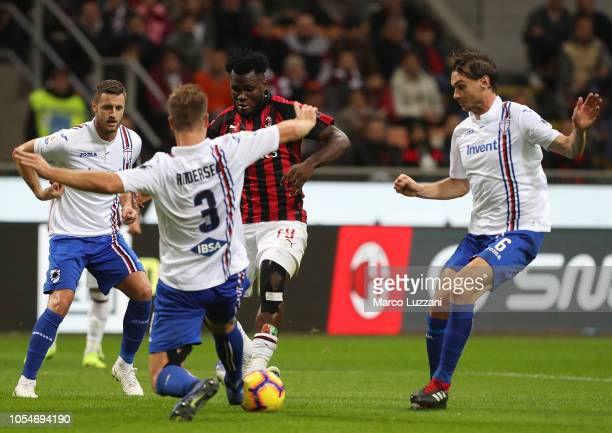 Franck Kessie of AC Milan is challenged by Joachim Andersen of UC Sampdoria during the Serie A match between AC Milan and UC Sampdoria at Stadio...