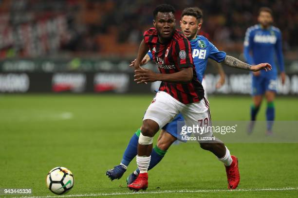 Franck Kessie of AC Milan is challenged by Stefano Sensi of US Sassuolo during the serie A match between AC Milan and US Sassuolo at Stadio Giuseppe...