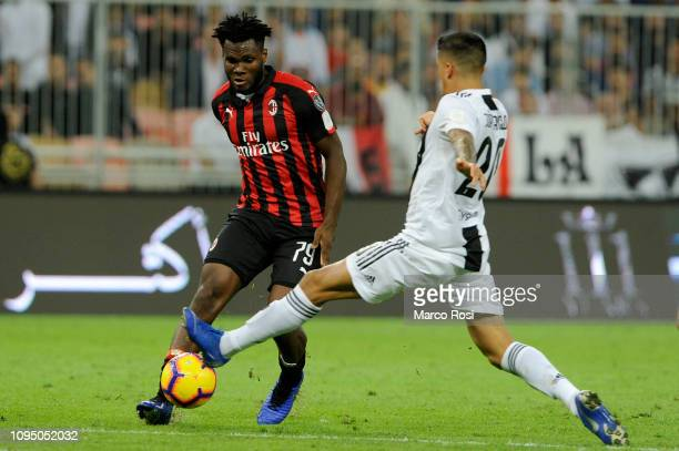 Franck Kessie of AC Milan is tackled by Joao Cancelo of Juventus during the Italian Supercup match between Juventus and AC Milan at King Abdullah...