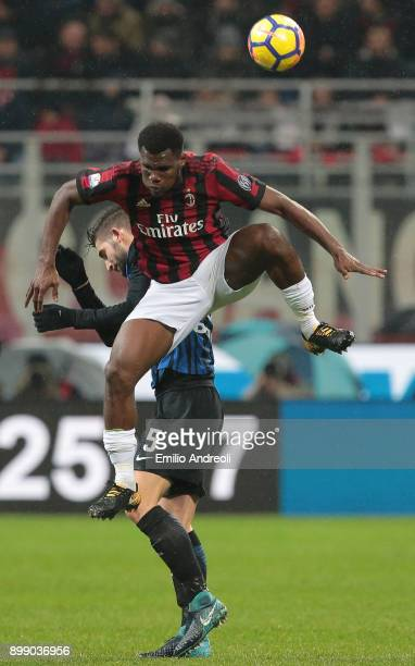Franck Kessie of AC Milan jumps for the ball against Roberto Gagliardini of FC Internazionale Milano during the TIM Cup match between AC Milan and FC...