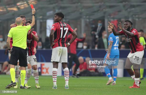 Franck Kessie of AC Milan reacts after receives a red card during the UEFA Champions League group B match between AC Milan and Atletico Madrid at...