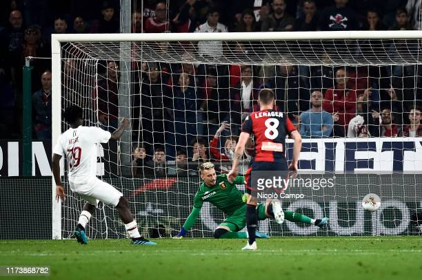 Franck Kessie of AC Milan scores a goal from a penalty kick during the Serie A football match between Genoa CFC and AC Milan. AC Milan won 2-1 over...