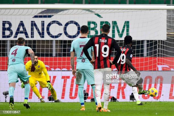 Franck Kessie of AC Milan scores a goal from a penalty kick during the Serie A football match between AC Milan and Torino FC. AC Milan won 2-0 over...