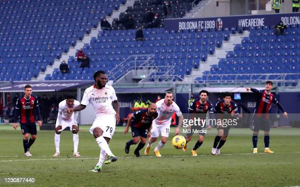 Franck Kessie of AC Milan scores a penalty during the Serie A match between Bologna FC and AC Milan at Stadio Renato Dall'Ara on January 30, 2021 in...