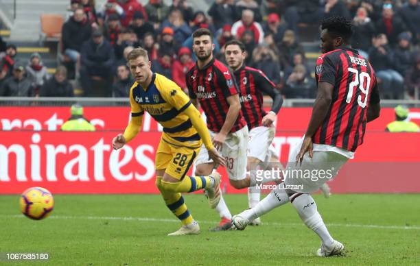 Franck Kessie of AC Milan scores his goal from the penalty spot during the Serie A match between AC Milan and Parma Calcio at Stadio Giuseppe Meazza...