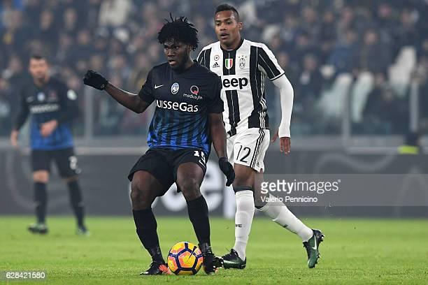 Franck Kessie of Atalanta BC in action against Alex Sandro of Juventus FC during the Serie A match between Juventus FC and Atalanta BC at Juventus...