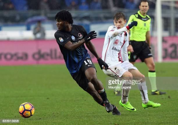 Franck Kessie of Atalanta competes for the ball with Nicolò Barella of Cagliari during the Serie A match between Atalanta BC and Cagliari Calcio at...