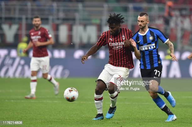 Franck Kessie of Milan and Marcelo Brozovic of Internazionale compete for the ball during the Serie A match between AC Milan and FC Internazionale at...