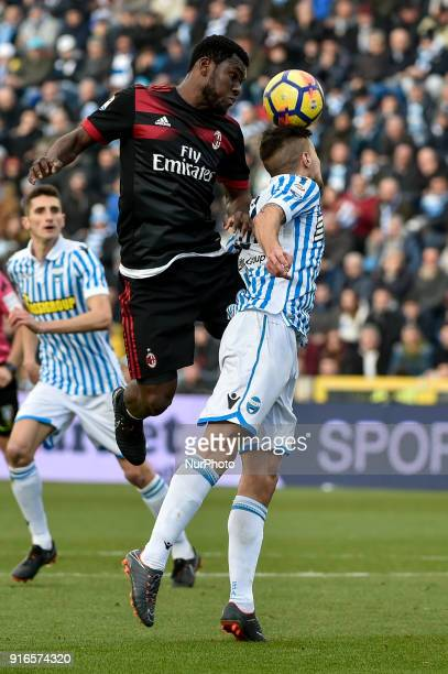 Franck Kessie of Milan is challenged by Lorenco Simi of SPAL during the Serie A match between SPAL and AC Milan at Paolo Mazza Stadium Ferrara Italy...