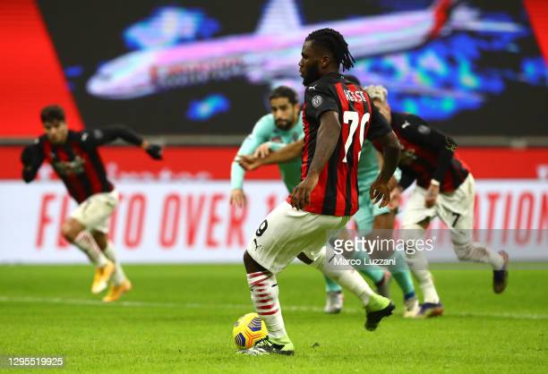 Franck Kessie of Milan scores their sides second goal form the penalty spot during the Serie A match between AC Milan and Torino FC at Stadio...
