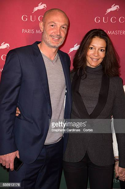 Franck Leboeuf and Chrislaure attend the Gucci Grand Prix during the Gucci Paris Masters 2013 in Paris