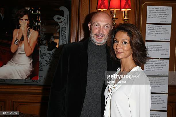 Franck Leboeuf and wife Chrislaure Nollet attend the Nathalie Garcon Cocktail Party In Paris on October 13 2014 in Paris France