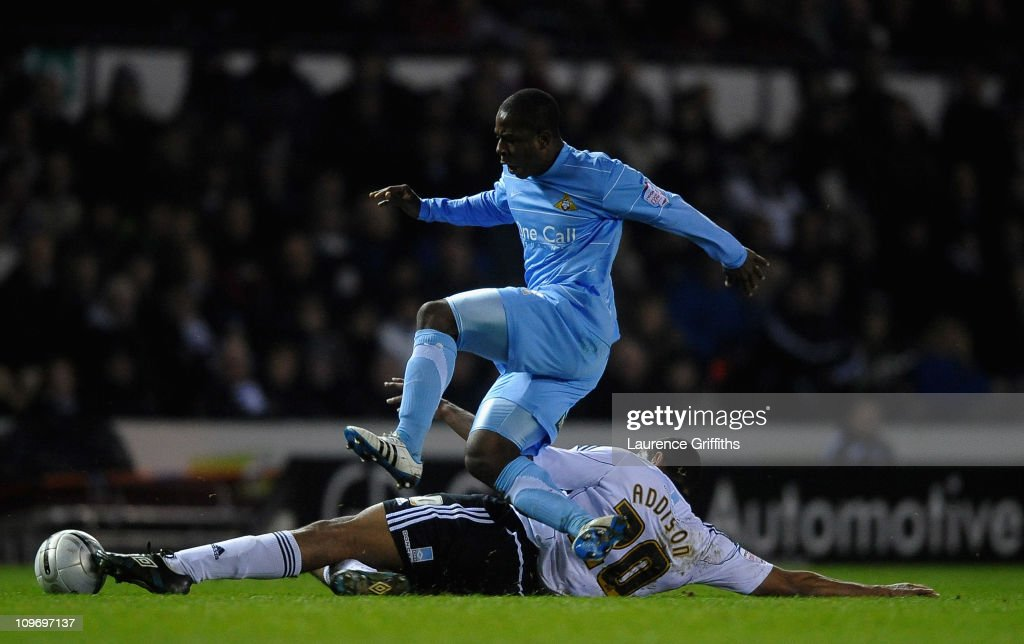 Franck Moussa of Doncaster Rovers battles with Miles Addison of Derby County during the npower Championship match between Derby County and Doncaster Rovers at Pride Park on March 1, 2011 in Derby, England.