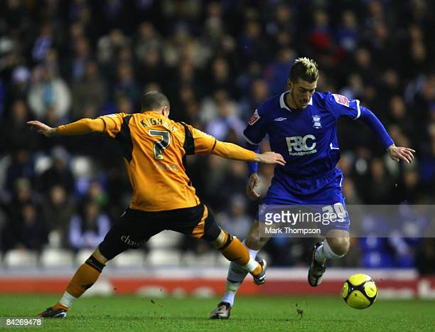 Franck Queudrue of Birmingham tangles with Michael Kightly of Wolves during the FA Cup sponsored by EON Third round match between Birmingham City and...