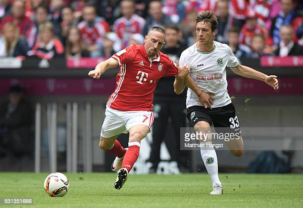 Franck Rebery of Bayern Muenchen and Fynn Arkenberg of Hannover 96 compete for the ball during the Bundesliga match between FC Bayern Muenchen and...