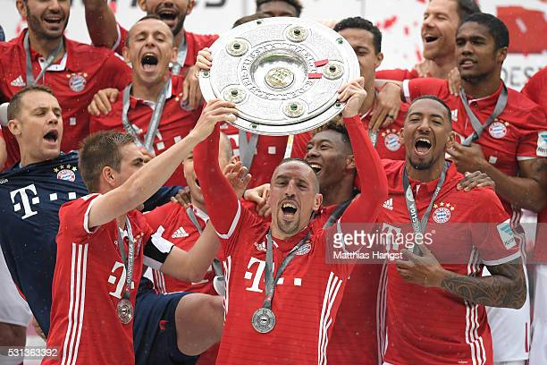 Franck Rebery of Bayern Muenchen lifts the Meisterschale as players and staffs celebrate the Bundesliga champions after the Bundesliga match between...