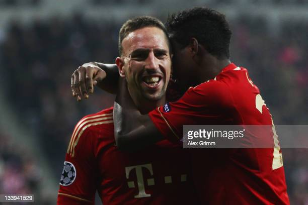 Franck Ribery 8l9 of Muenchen celebrates his team's third goal with team mate David Alaba during the UEFA Champions League Group A match between FC...
