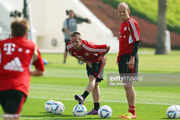 Franck Ribery and Arjen Robben look on during a training session of Bayern Muenchen at the ASPIRE Academy for Sports Excellence on January 5 2012 in...