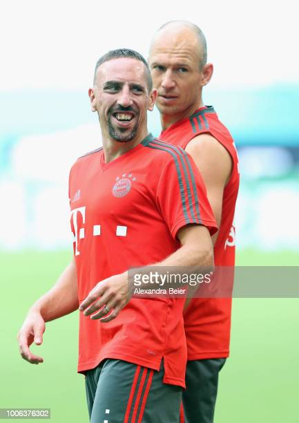 Franck Ribery and Arjen Robben of FC Bayern Muenchen practice during a training session ahead of the team's friendly match aganst Manchester City on...