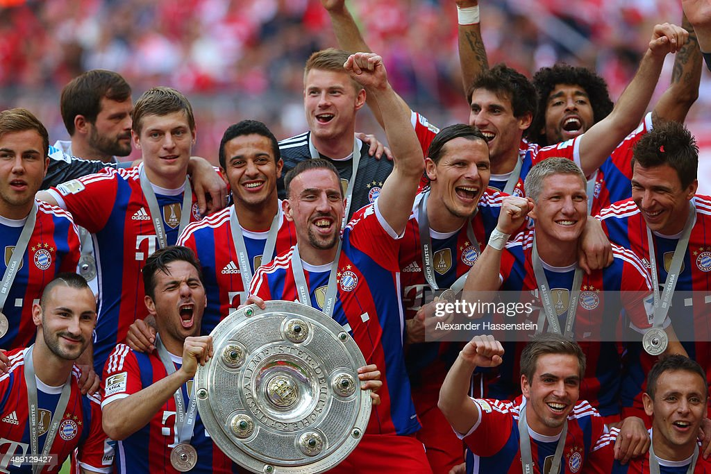 Franck Ribery and Claudio Pizarro of Bayern Muenchen hold the Bundesliga championship trophy in celebration after the Bundesliga match between Bayern Muenchen and VfB Stuttgart at Allianz Arena on May 10, 2014 in Munich, Germany.