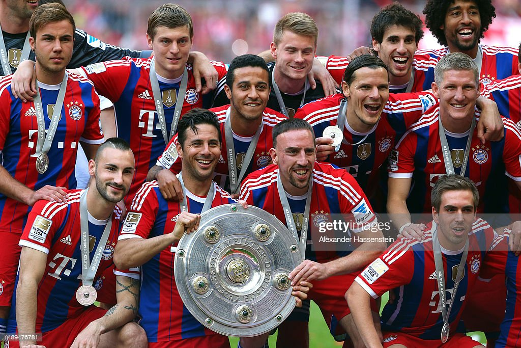 Franck Ribery (C) and Claudio Pizarro (C-L) of Bayern Muenchen hold the Bundesliga championship trophy in celebration after the Bundesliga match between Bayern Muenchen and VfB Stuttgart at Allianz Arena on May 10, 2014 in Munich, Germany.