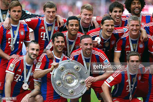 Franck Ribery and Claudio Pizarro of Bayern Muenchen hold the Bundesliga championship trophy in celebration after the Bundesliga match between Bayern...